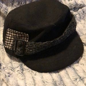 Black cap with gray band and buckle